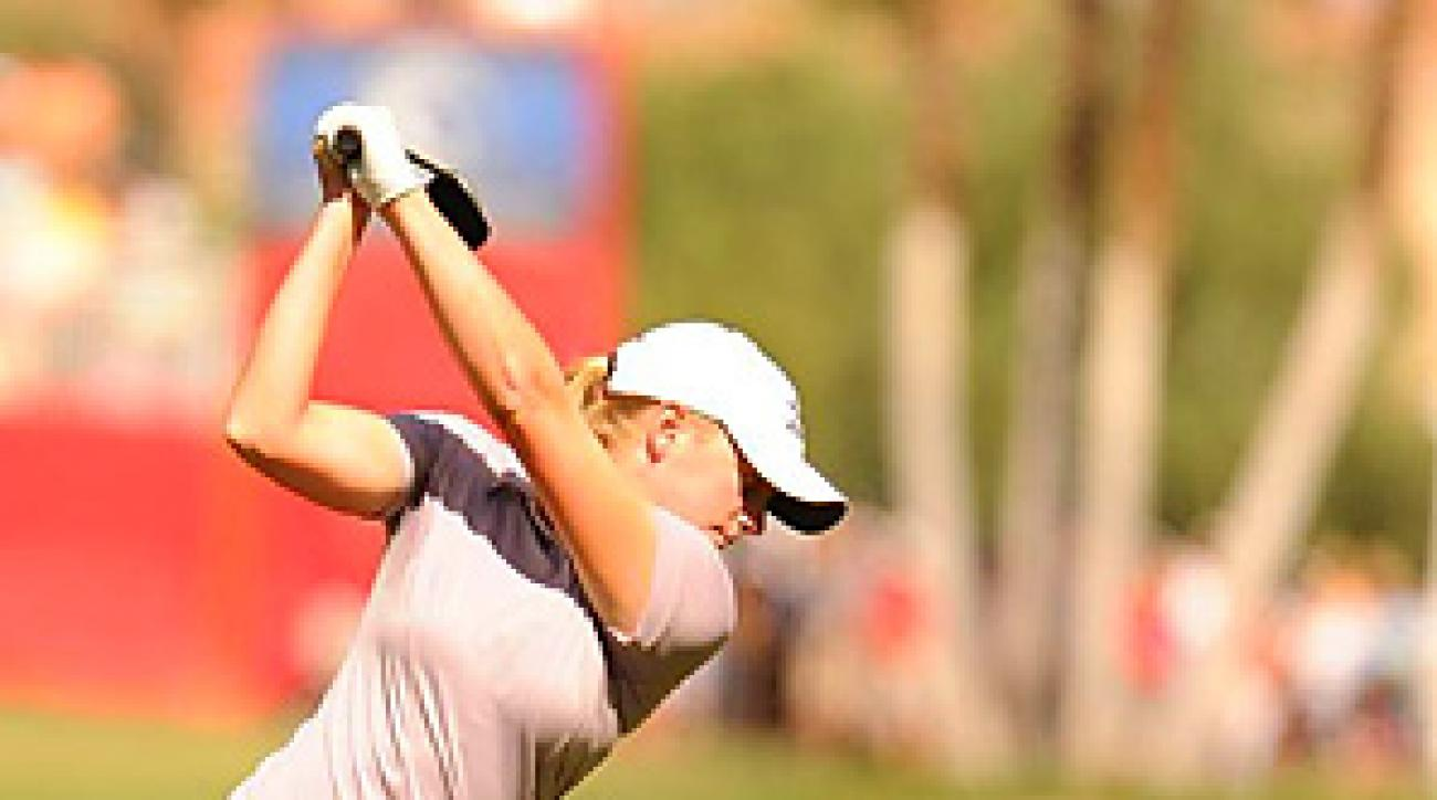 Stacy Lewis shot a 3-under 69 while going head-to-head with Yani Tseng, the world's top-ranked player.
