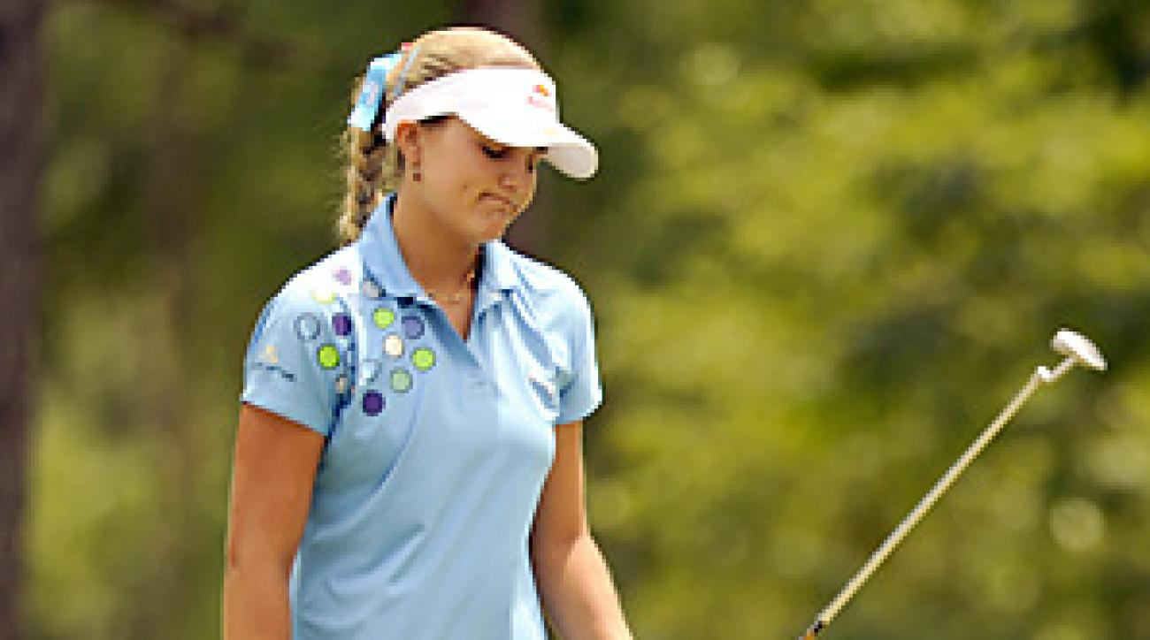 Lexi Thompson's bid to become the LPGA's youngest winner crumbled amid errant, water-logged shots.