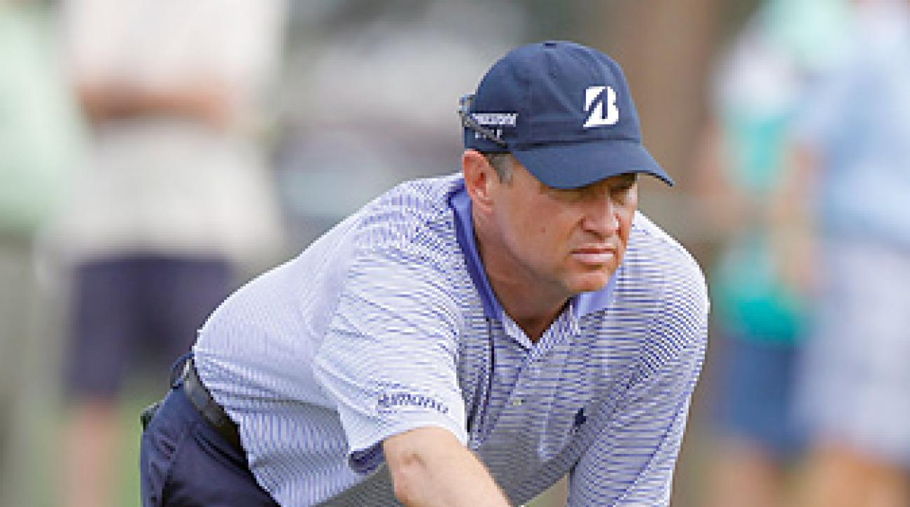 Davis Love III tied the course record with an opening-round 64.