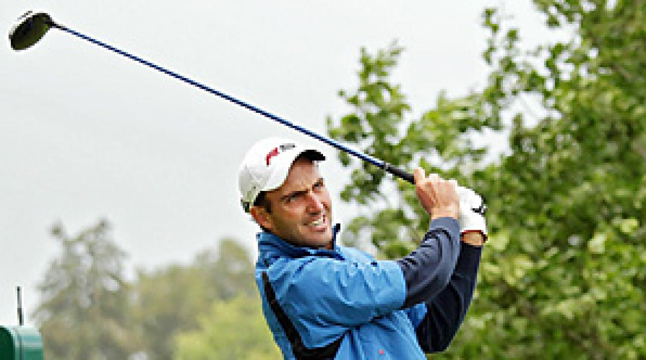 Edoardo Molinari's final-round 74 was enough to beat Darren Clarke by three strokes.