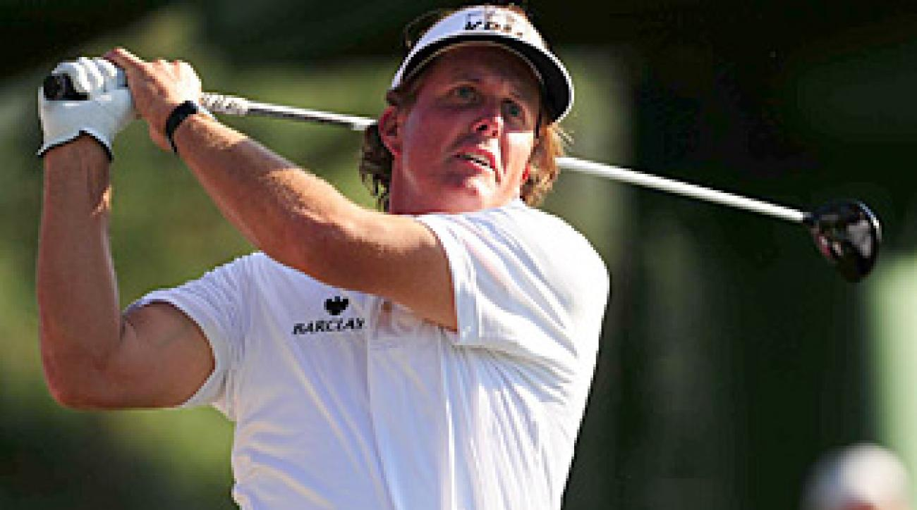 Phil Mickelson shot a 66 on Saturday and trails Peter Hanson by one shot heading into the final round.