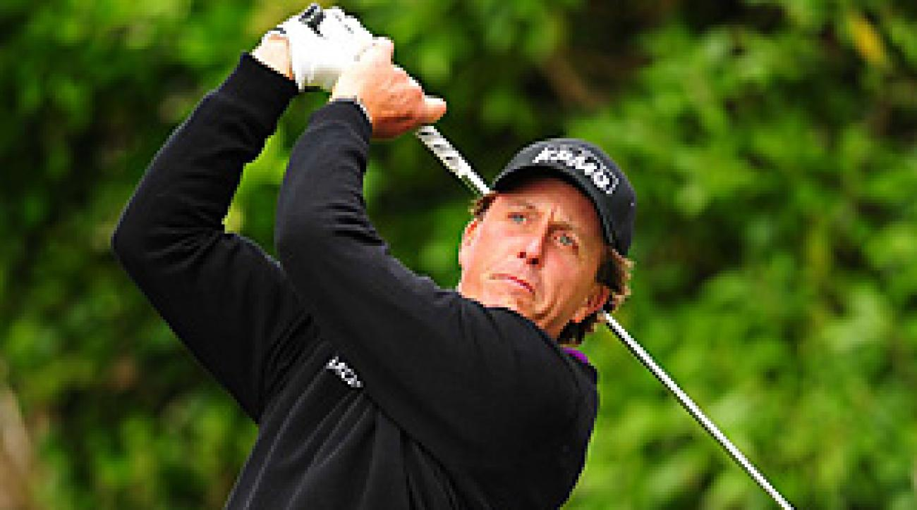 Phil Mickelson stormed back into contention with a second-round 66.