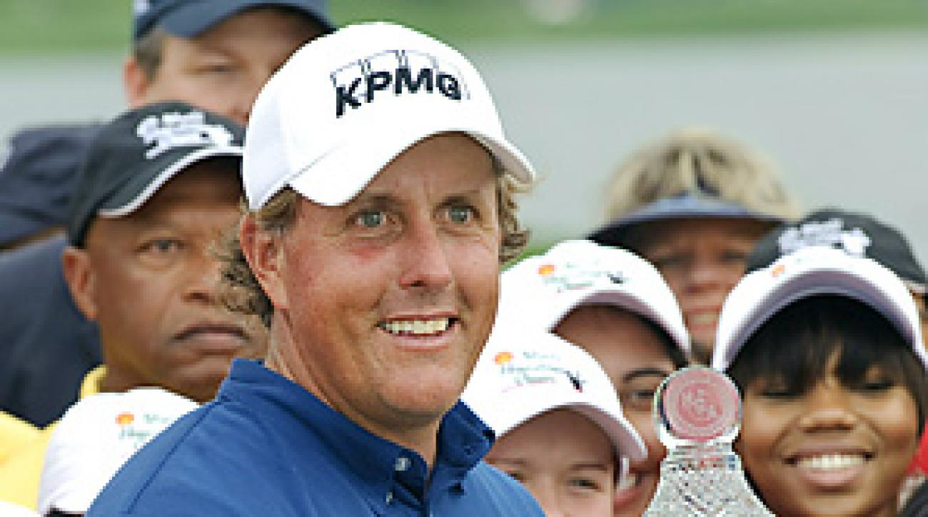 Phil Mickelson shot a 65 to earn his first victory since last year's Masters.