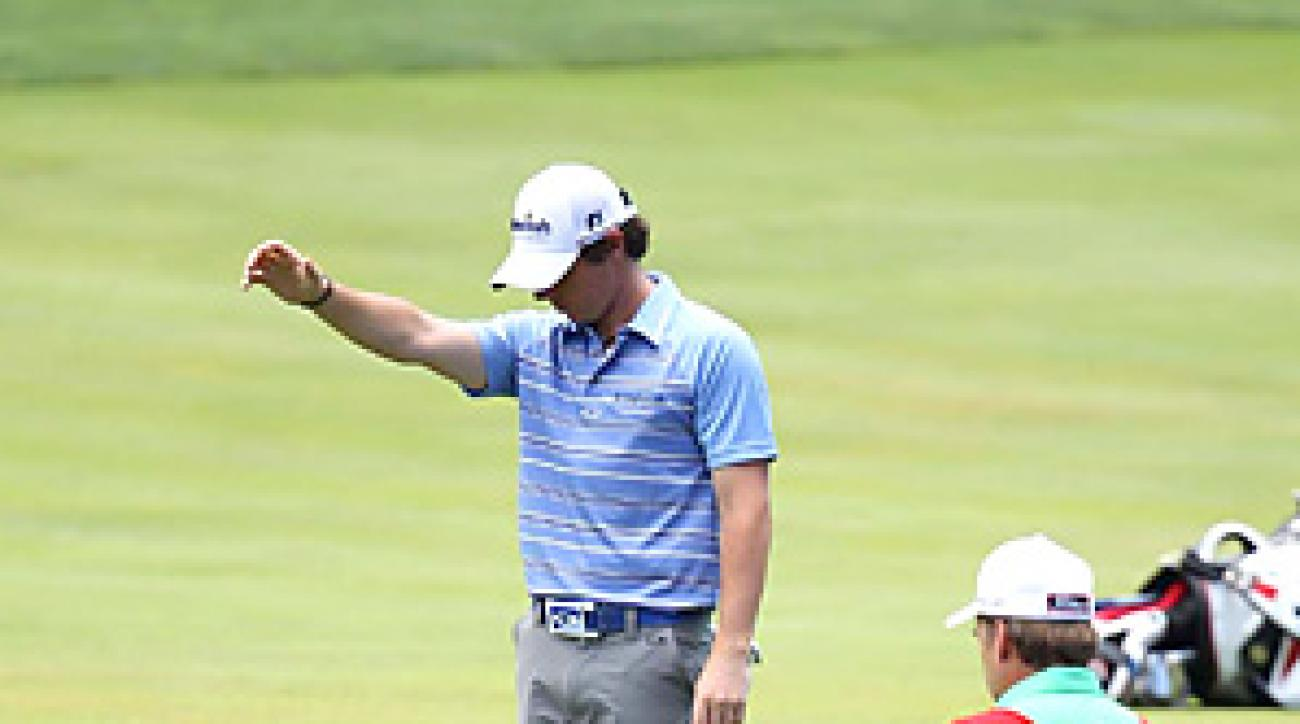 Rory McIlroy made a double bogey on 18 but still shot 66. He is a record 11 under through 36 holes.
