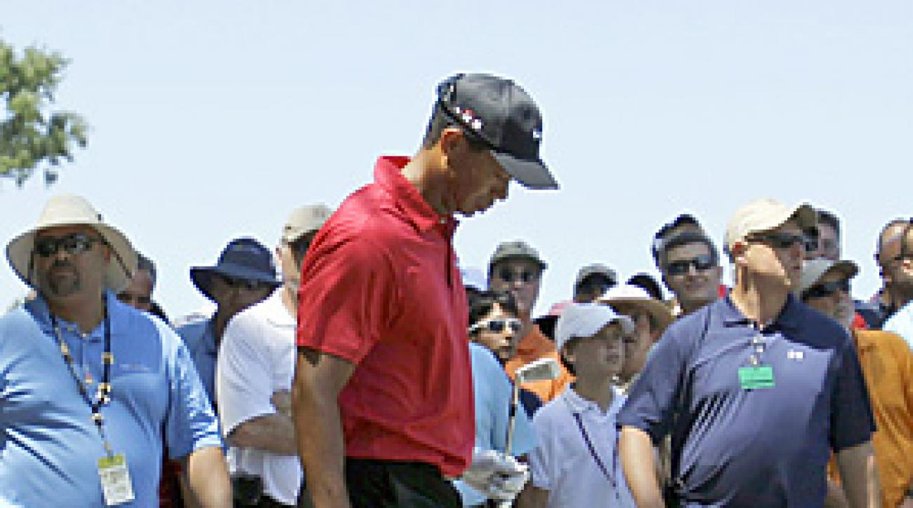 Tiger Woods ended his round after hitting an approach shot on the 7th hole.