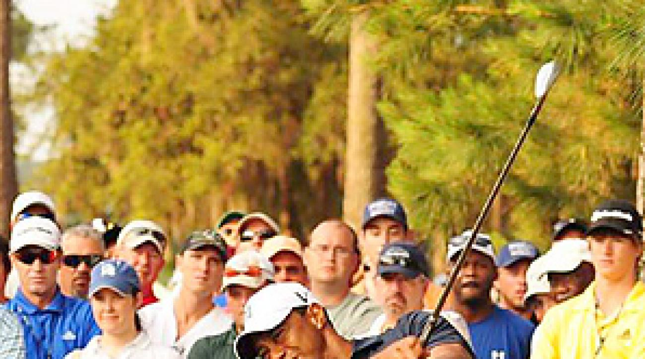 Tiger Woods hasn't played competitively since withdrawing from the Players Championship after nine holes.