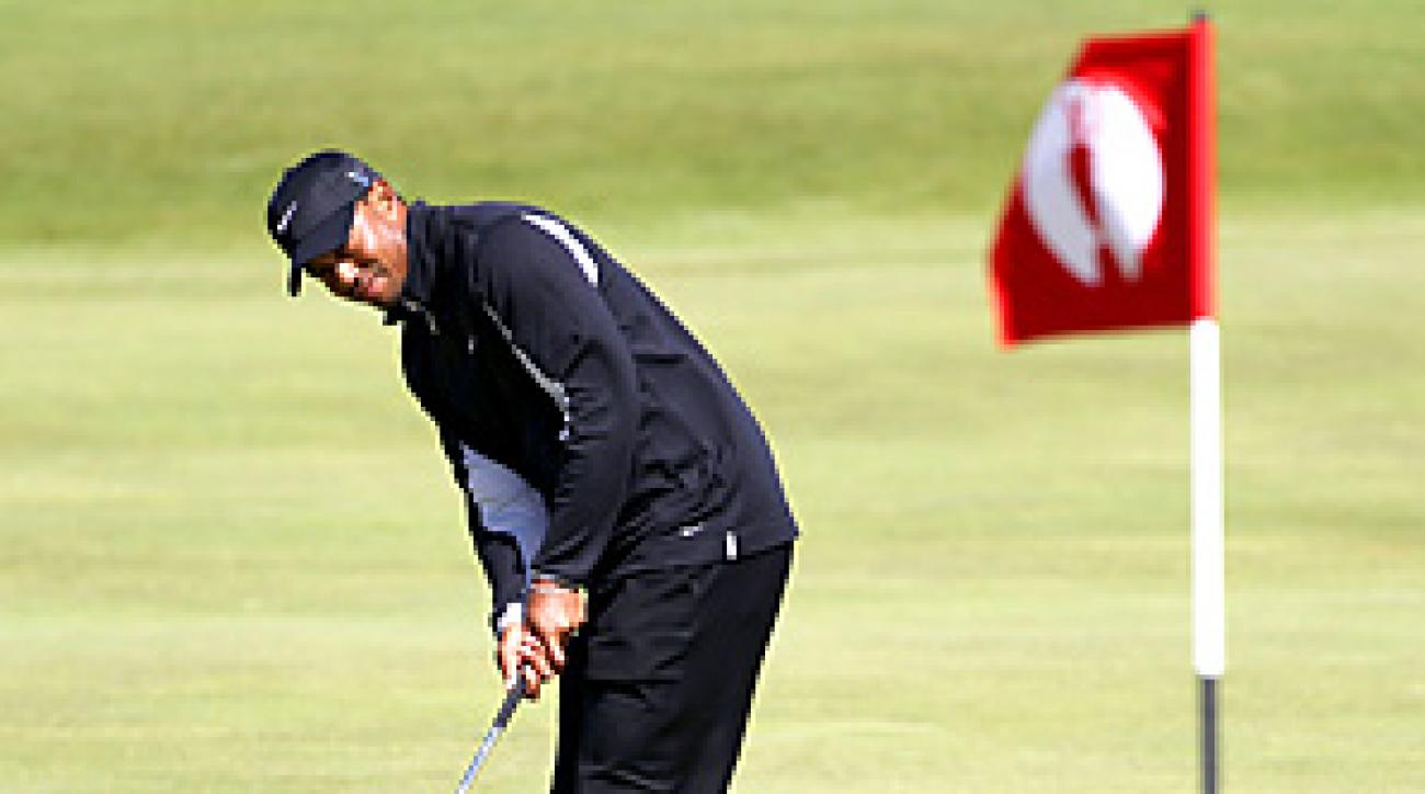 After taking time off to visit his children in Florida, Tiger Woods was on the course in St. Andrews for a Sunday practice round.