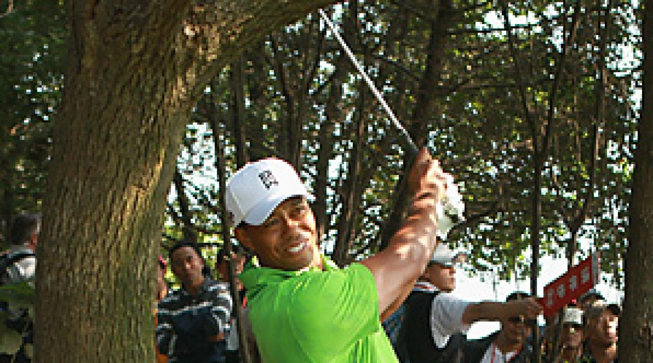 Tiger Woods shot a 68 in the opening round at the HSBC Champions in Shanghai.