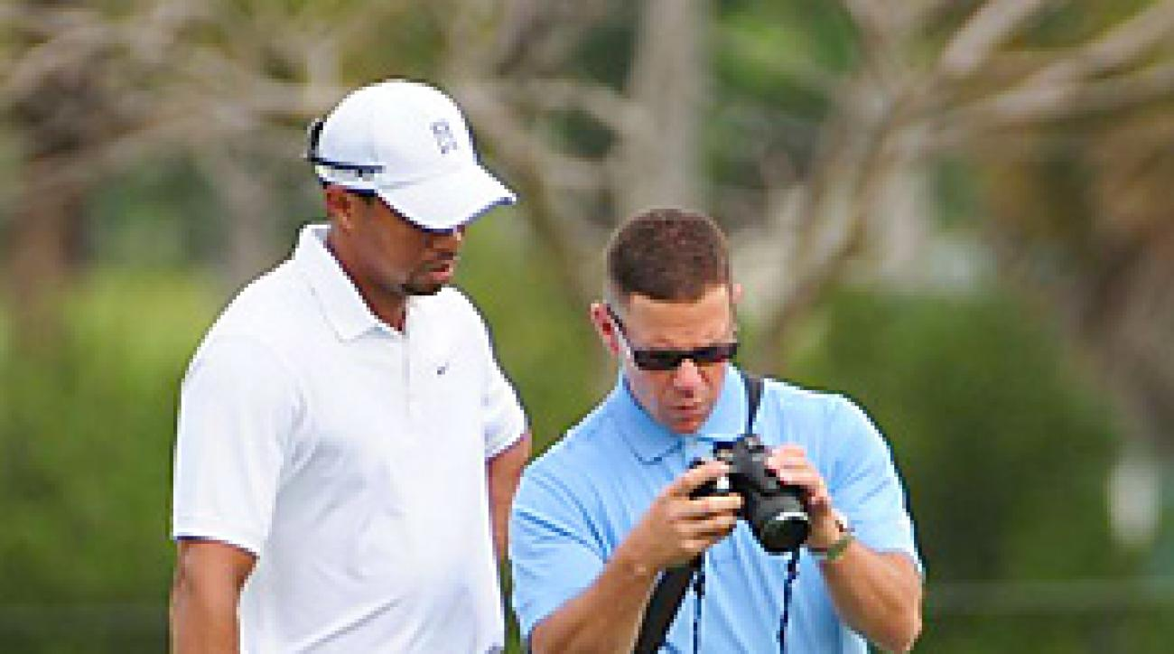 Tiger Woods spent much of his practice round watching his swing on new coach Sean Foley's camera.
