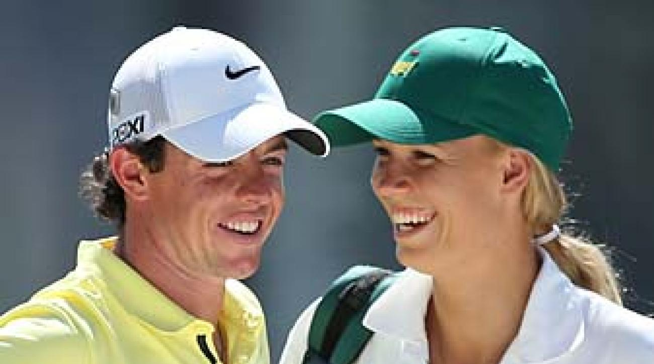 Rory McIlroy and caddie Caroline Wozniacki at the Masters Par 3 Contest on Wednesday. With crowds so close and the greens so small, the chance of a fan getting hit with a wayward shot is pretty high.