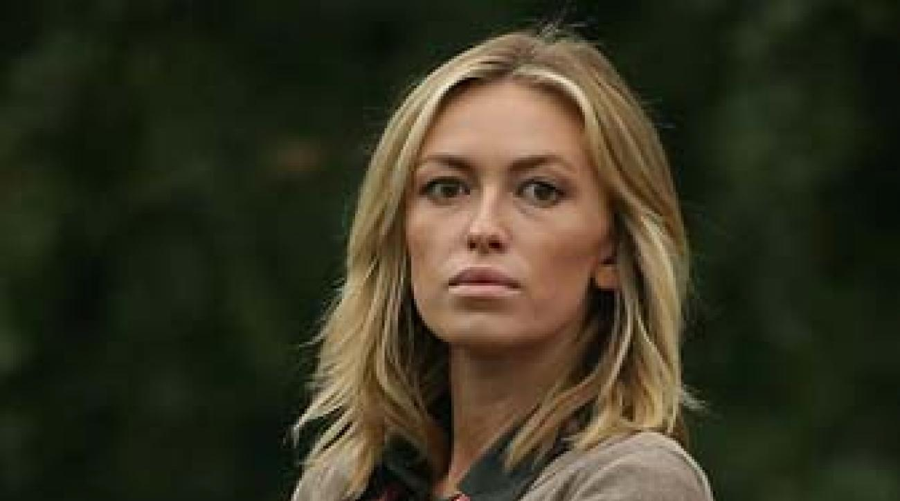 Paulina Gretzky, Dustin Johnson's fiancee, watches Johnson's thrilling victory in Shanghai on Sunday.