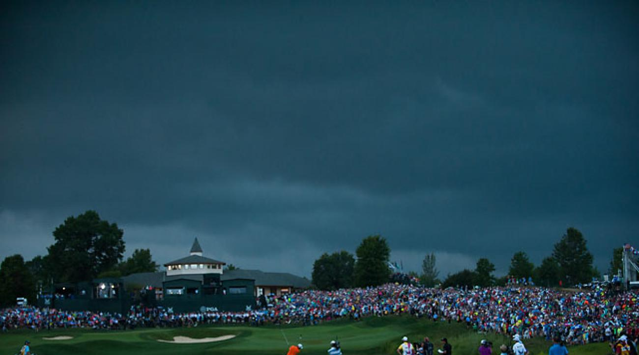 Rickie Fowler hits his second shot to the par-5 18th hole in the final round of the 2014 PGA Championship at Valhalla.