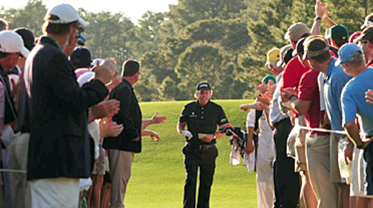 Phil Mickelson interacting with fans at the 2010 Masters.
