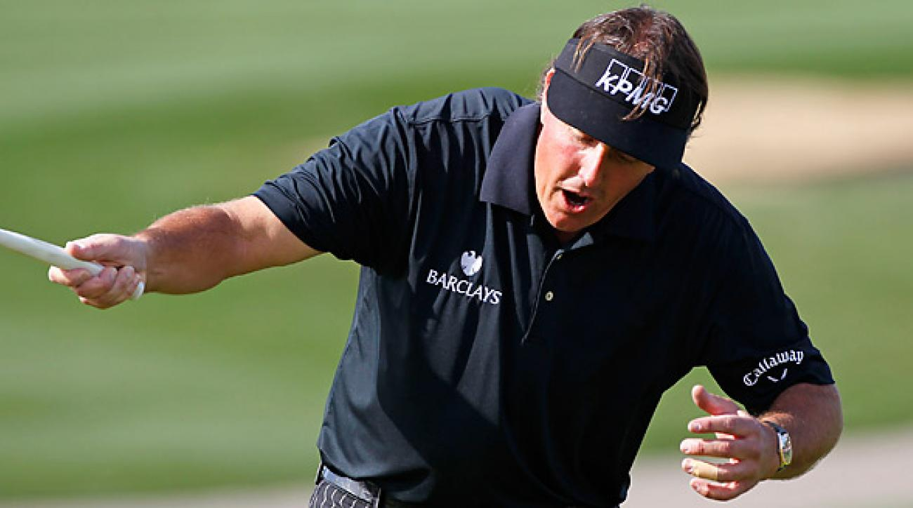 Phil Mickelson reacts after his putt for a 59 lipped out on the final hole.