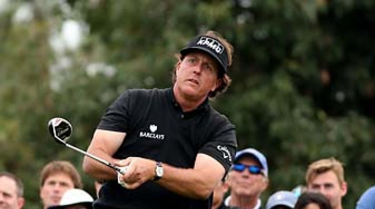 Phil Mickelson watches his tee shot during the second round of the Farmers Insurance Open. He was unable to finish the tournament because of his bad back.