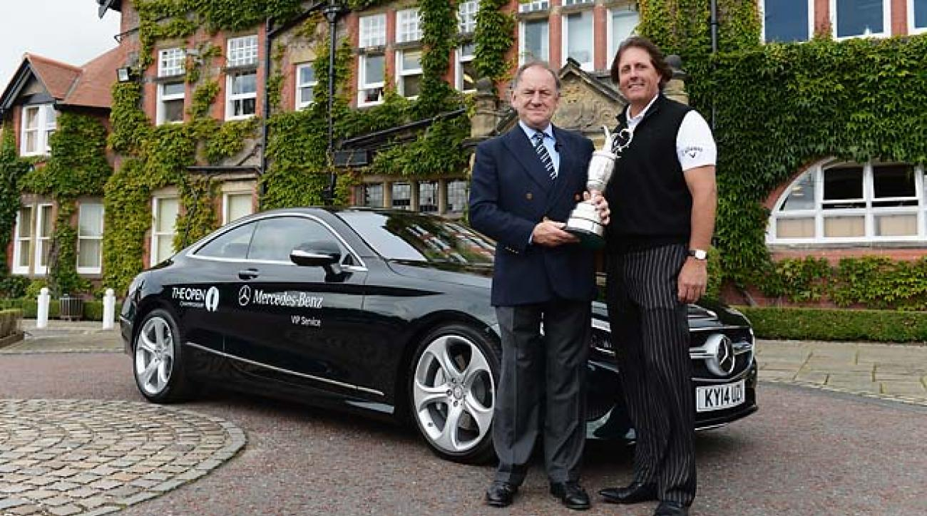 Phil Mickelson returns the Claret Jug to the R&A's Peter Dawson on Monday at Royal Liverpool.