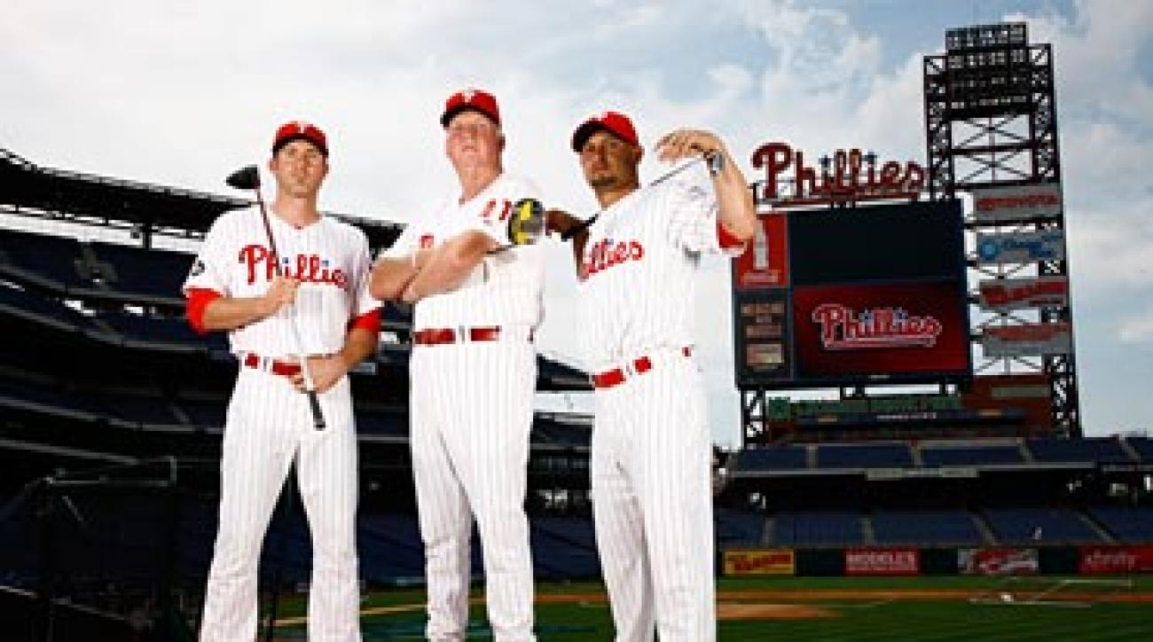 Chase Utley, Charlie Manuel and Shane Victorino