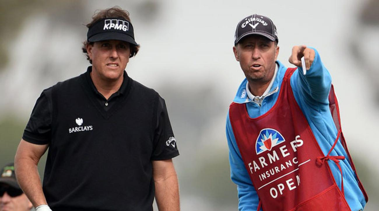 "Phil Mickelson gets some advice from caddie Jim ""Bones"" Mackay at Torrey Pines during the second round."