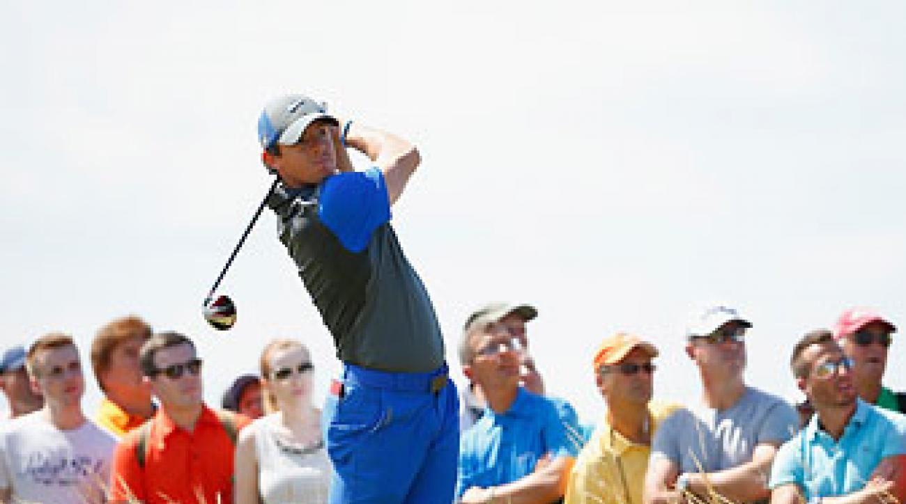 Rory McIlroy tees off in the opening round of the British Open at Royal Liverpool.