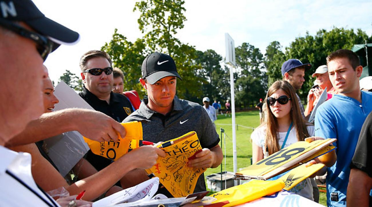 Rory McIlroy signs autographs during a practice round Wedensday at East Lake Country Club in Atlanta.