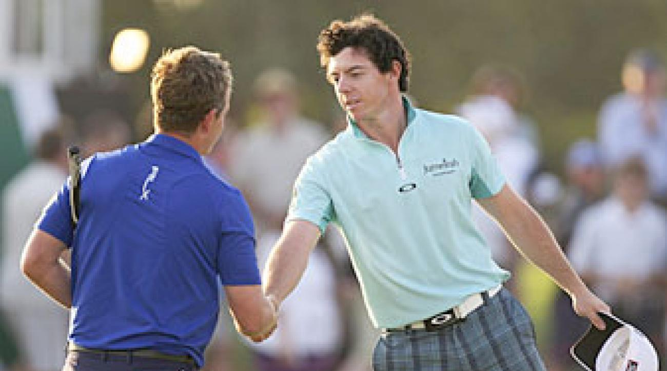 Rory McIlroy, right, beat Luke Donald by six strokes in the first round.