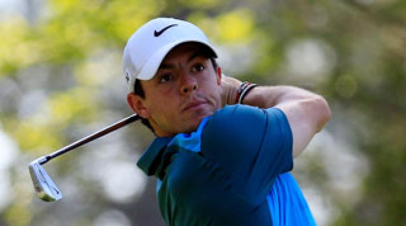 Rory McIlroy watches his tee shot on the fourth hole during the third round of the 2014 Masters.