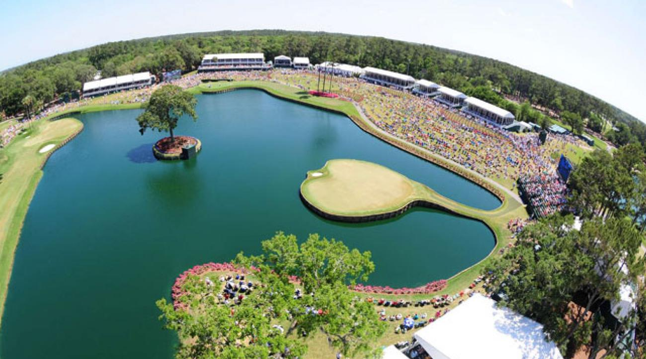 The 17th hole at TPC Sawgrass provides several splashes for the fans on Sunday of the Players Championship.