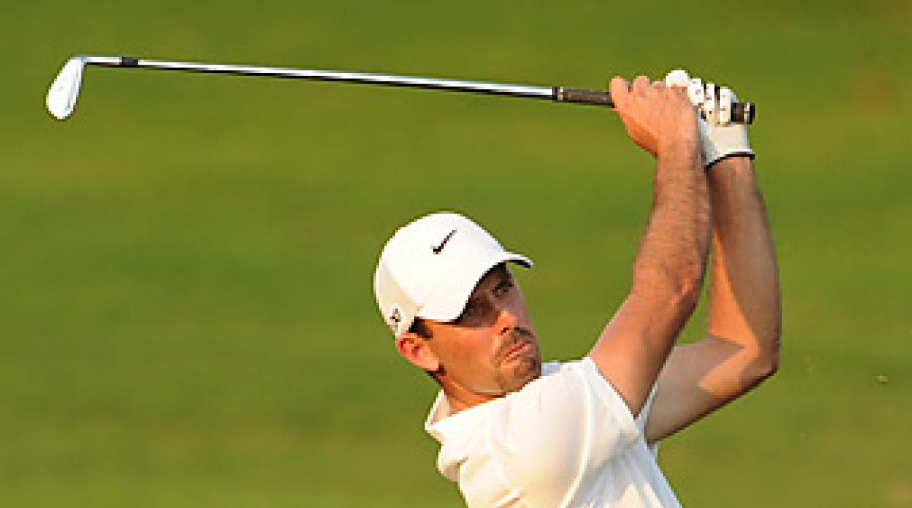 Charl Schwartzel fired a 65 to take a four-shot lead.