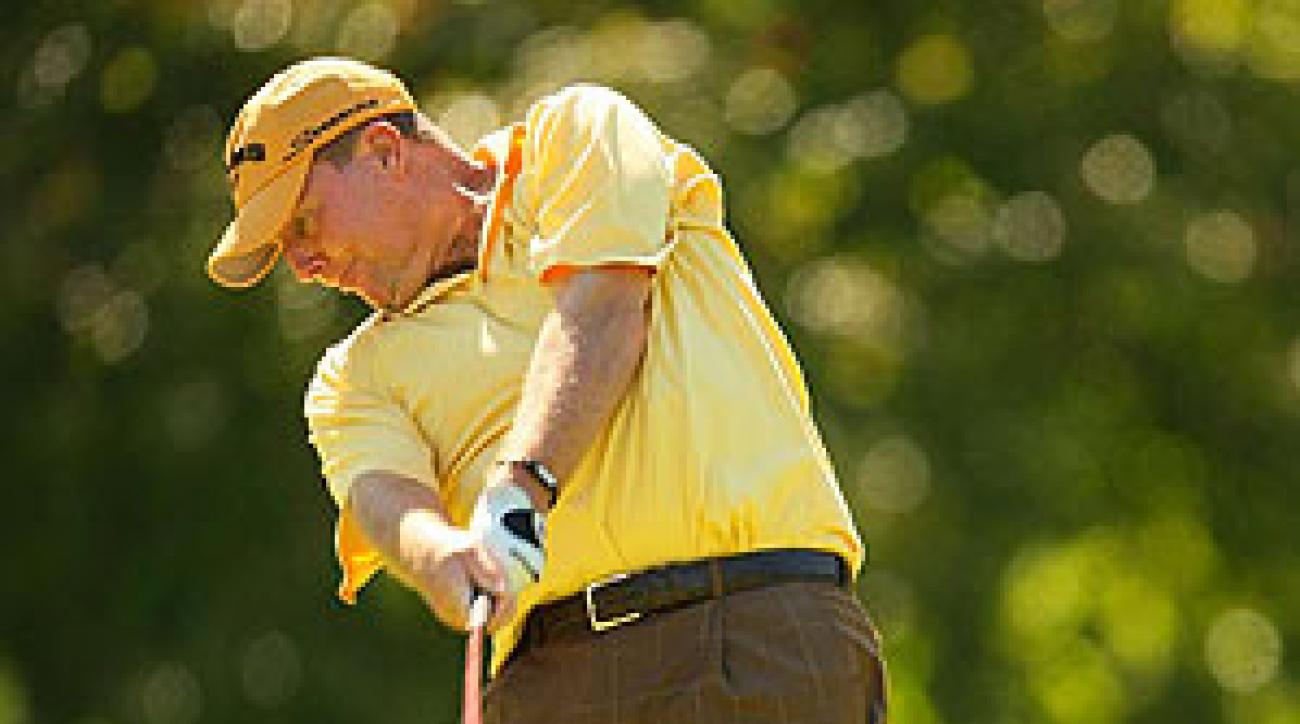 Scott Hoch shot a four-under 66 for a share of the lead.