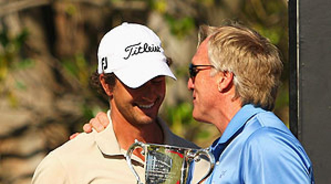 Greg Norman presented the trophy to Adam Scott.