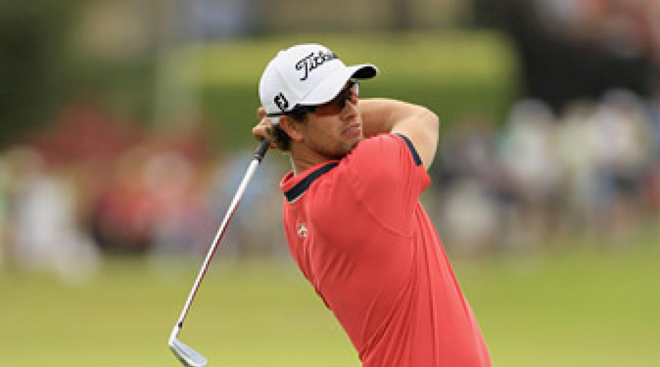 Adam Scott shot a six-under 66 to take the first-round lead.