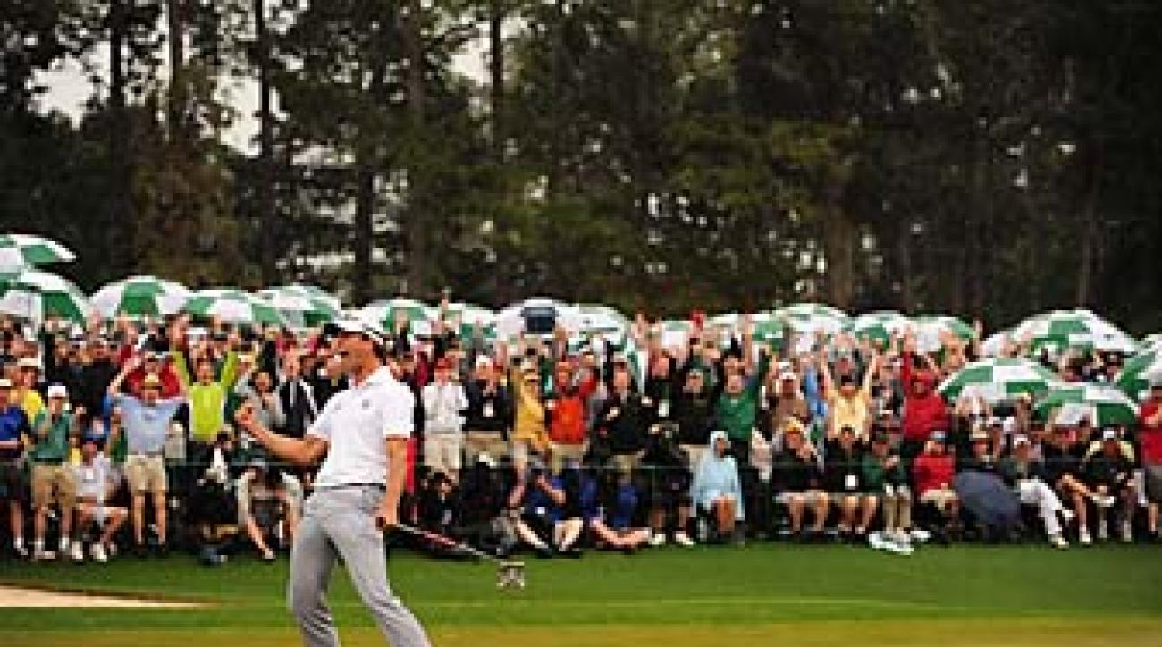 Adam Scott sinks the winning putt at the 2013 Masters. After winning the tournament, Scott has worn the green jacket every day.