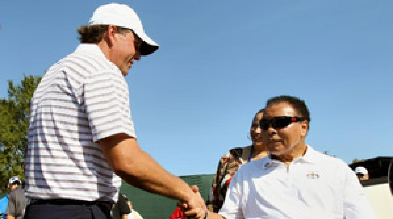 Before his practice round, Phil Mickelson chatted with boxing great Muhammad Ali.
