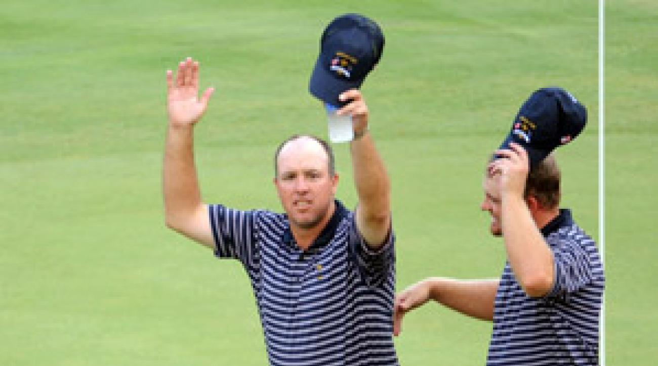 Boo Weekley, left, and J.B. Holmes won an afternoon match for the U.S.