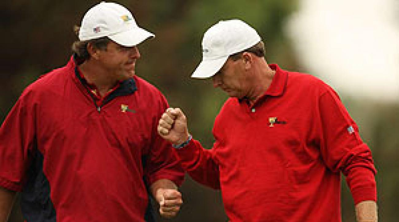 Phil Mickelson and Woody Austin halved their match against Vijay Singh and Mike Weir.