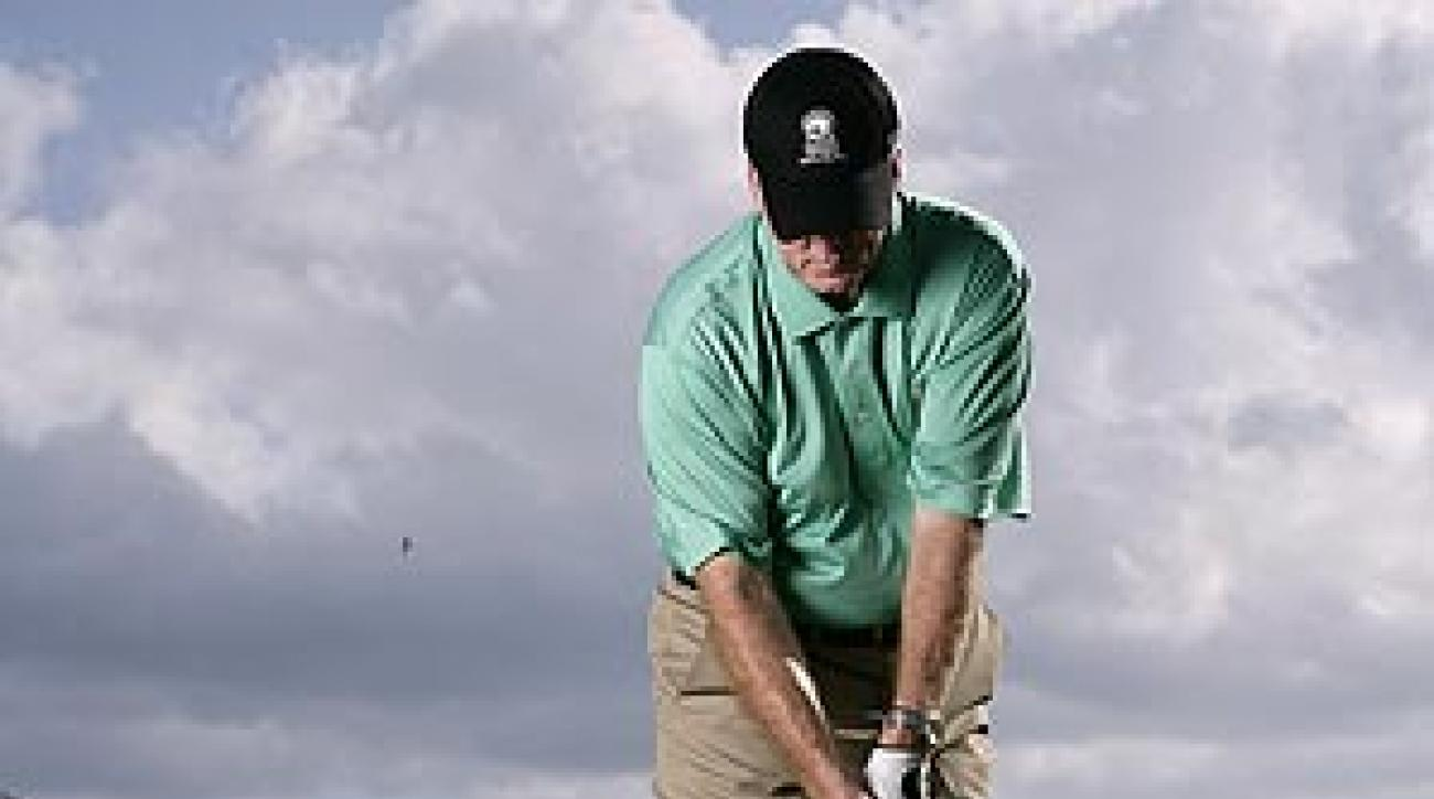 Set the brim of your cap along the outer club on the ground at address and keep it there.