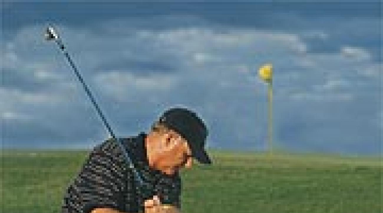 Make your normal bunker swing with a pitching wedge.