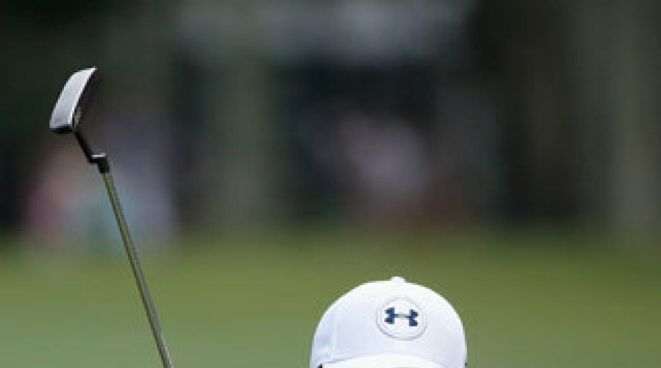 Jordan Spieth of the United States reacts to a missed birdie putt on the ninth green during the final round of the Players Championship.