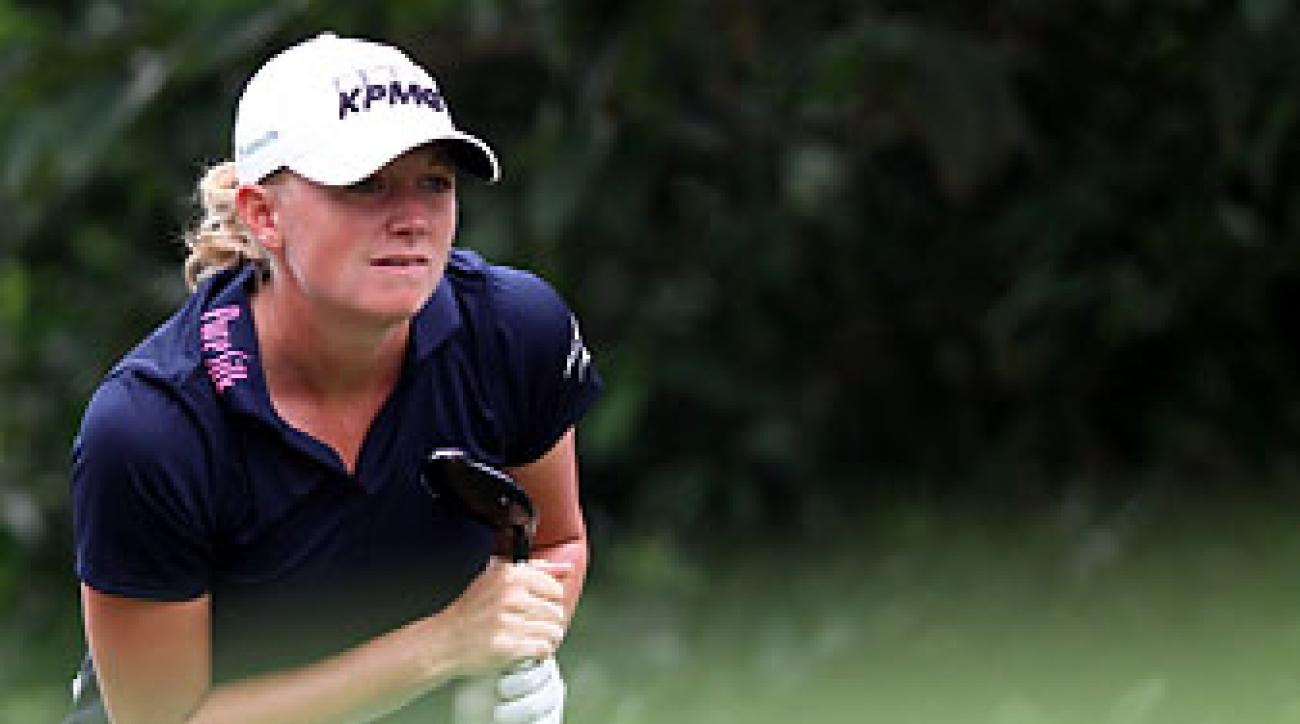 Stacy Lewis watches her tee shot on the 4th hole at the 2014 Sime Darby LPGA at Kuala Lumpur Golf & Country Club in Malaysia.