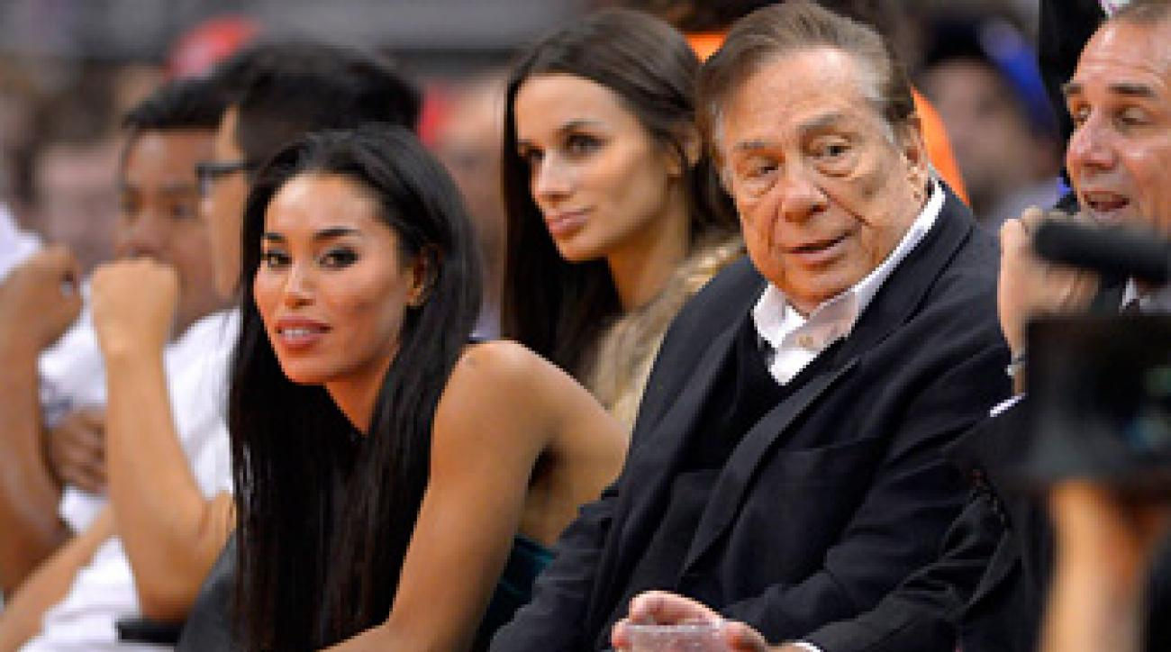Donald Sterlng and girlfriend V. Stiviano attend a Clippers game in October 2013.