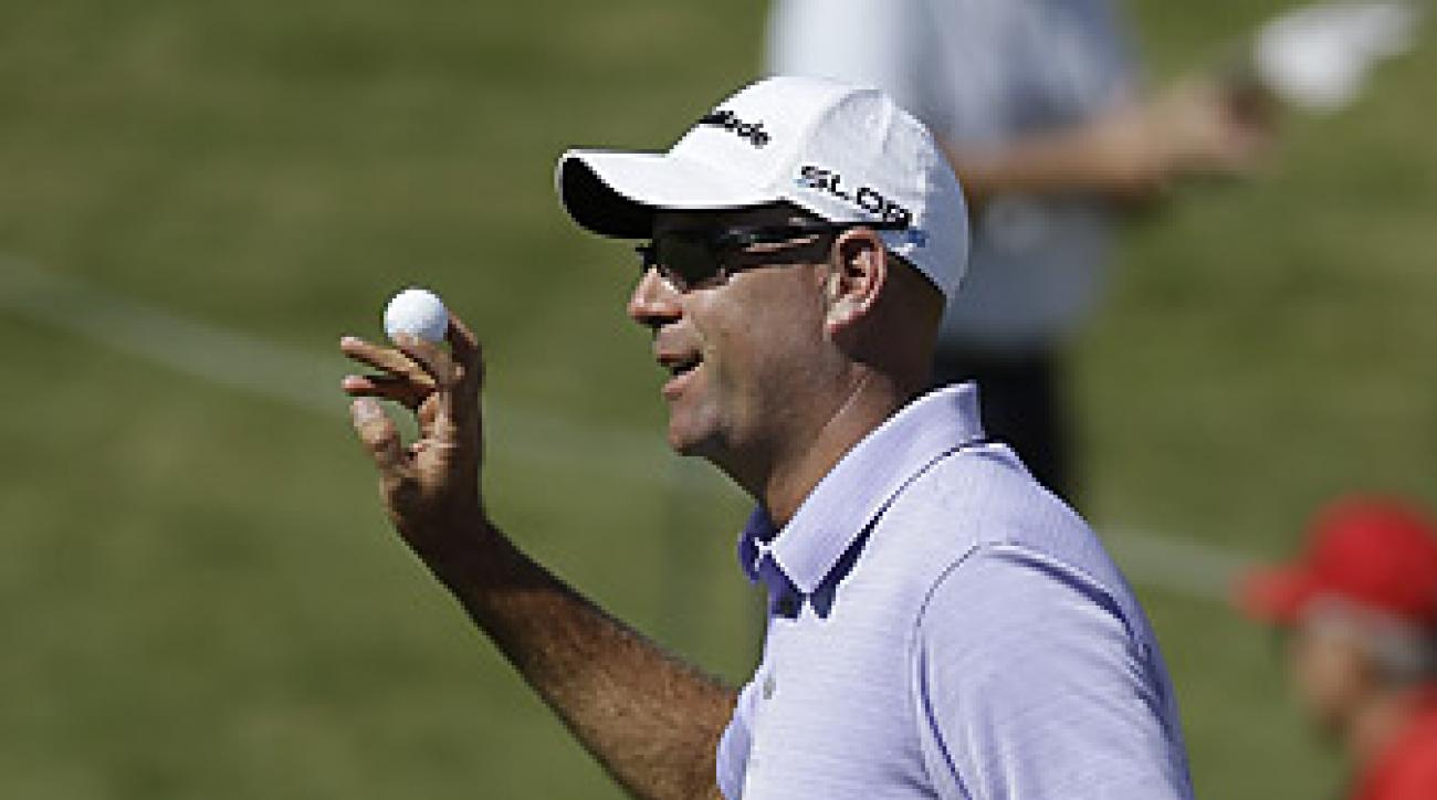 Stewart Cink shot a 64 in the first round to tie for the lead.