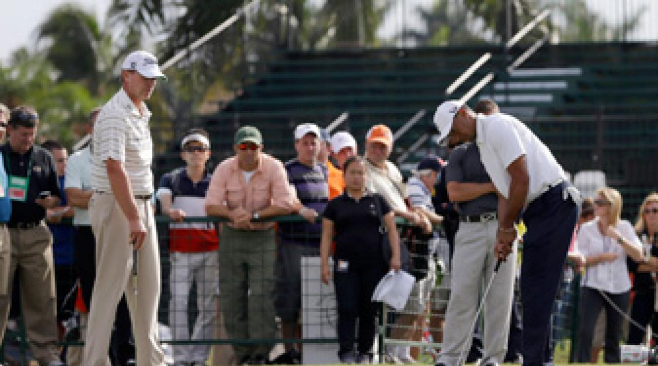 Steve Stricker, left, helped Tiger Woods with his putting at Doral.