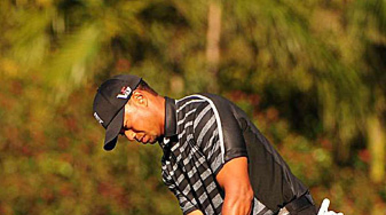 Woods is tied with four others at six under.