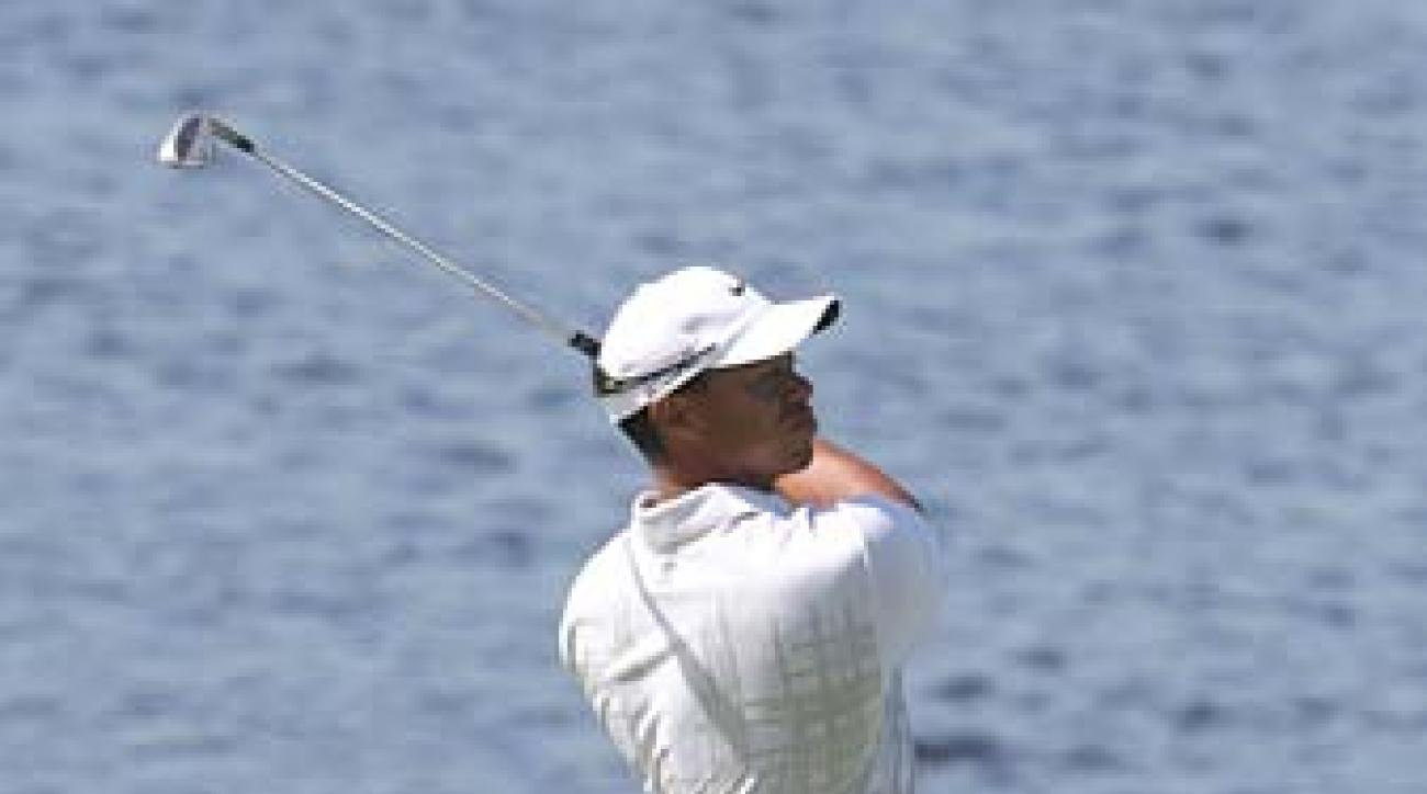 Tiger Woods made seven birdies on his way to a round of 67.