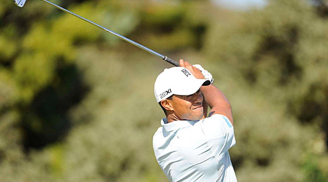 Woods once again scrambled to finish with a solid even-par 71.
