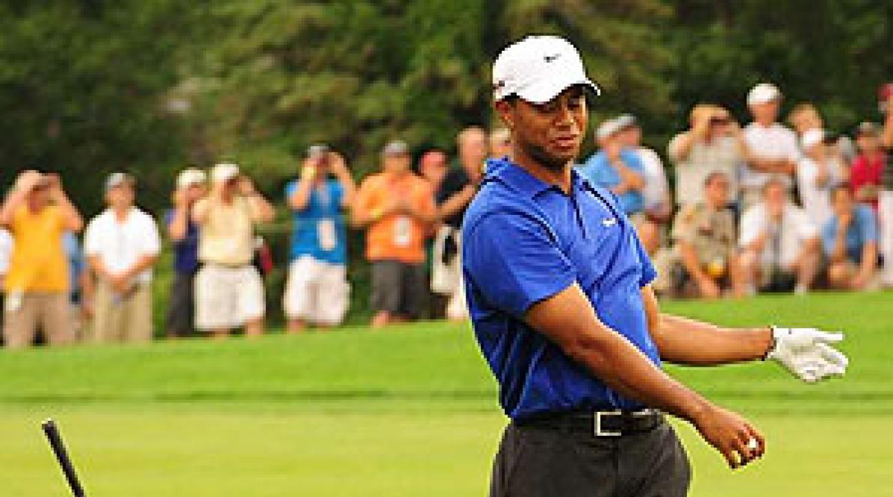 Woods kept it clean at Hazeltine, but still tossed the odd club.