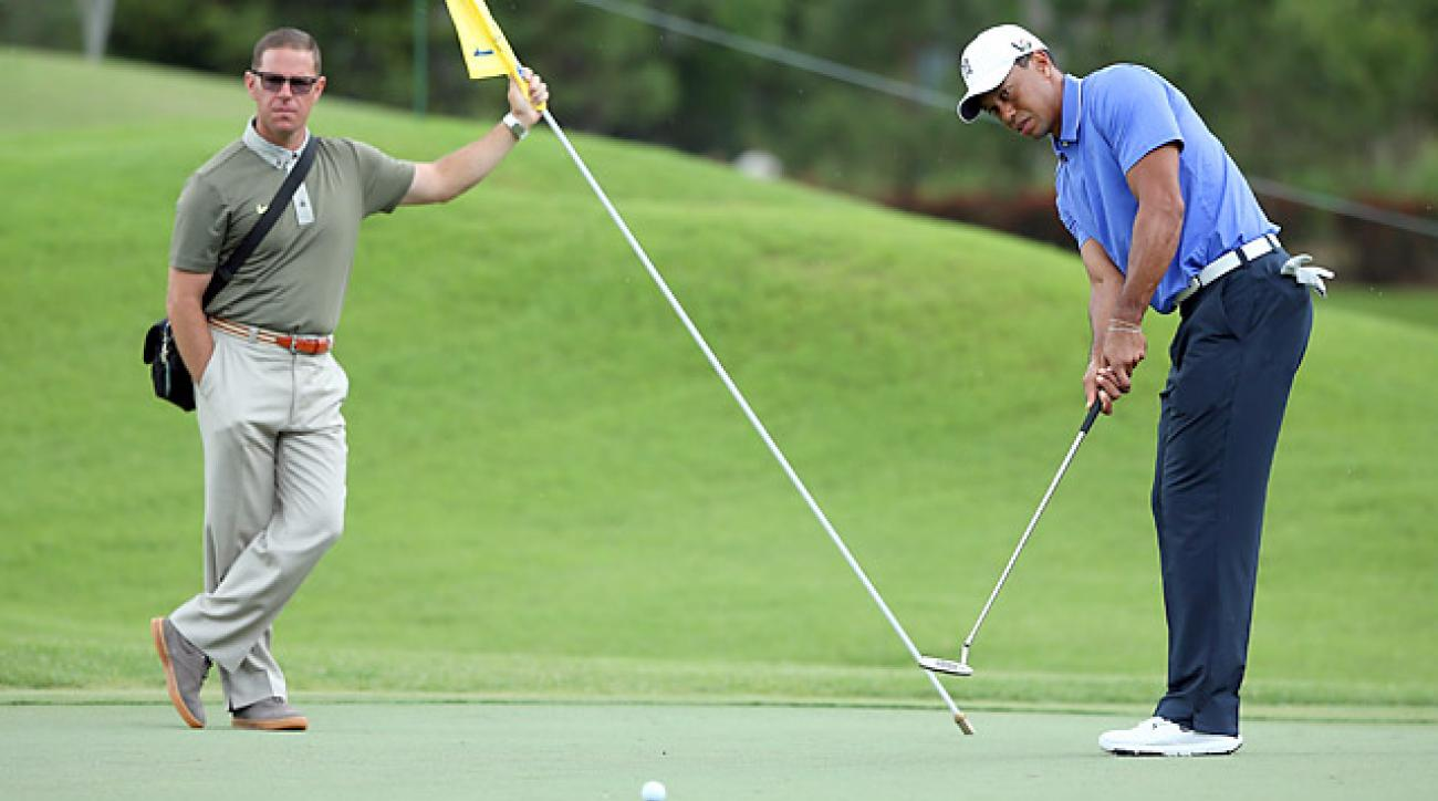 You have as much golf talent as Tiger Woods [with Sean Foley, left]. You just haven't spent thousands of hours practicing.