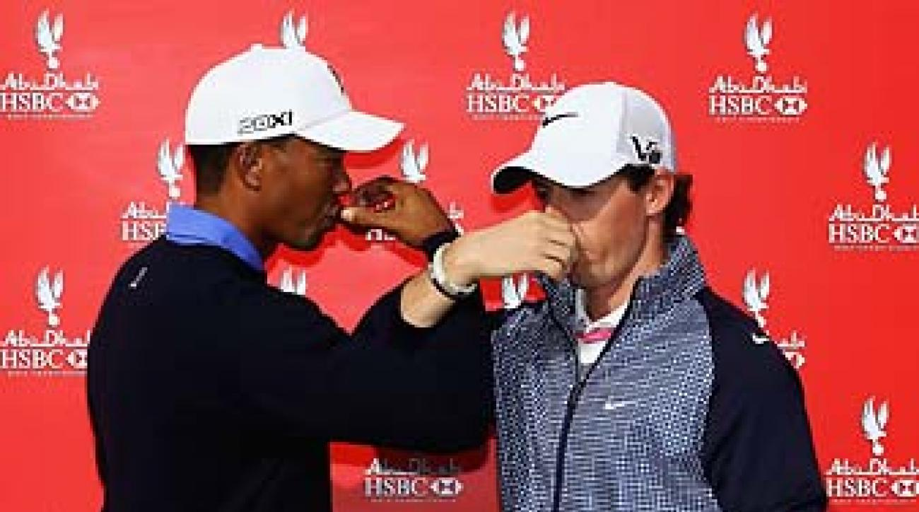 Tiger Woods and Rory McIlroy drink coffee at a publicity event prior to the start of the 2013 Abu Dhabi HSBC Golf Championship at Abu Dhabi Golf Club.