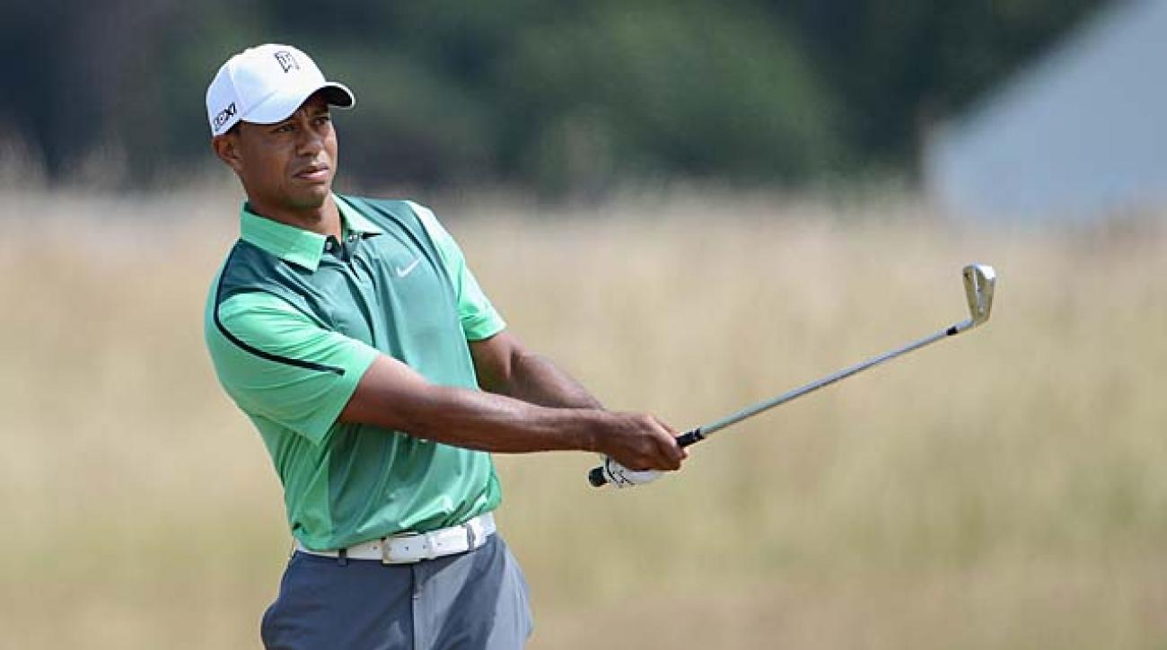 Tiger Woods hits a shot during a British Open practice round Sunday at Muirfield in Gullane, Scotland.