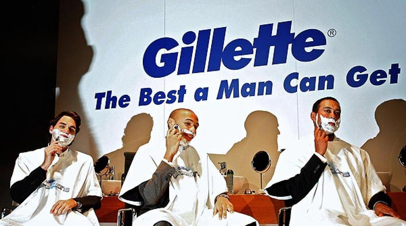 """Tiger Woods with Roger Federer, left, and Thierry Henry. All three were part of the Gillette's """"Champions"""" campaign."""